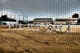 Higashi High baseball team hosing down a contaminated field.