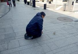 A beggar in the affluent Motomachi.