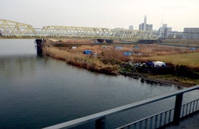 Blue tarp tents along the Edo River.